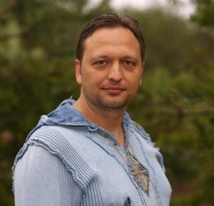 Алекс Томан